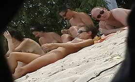 Voyeur has what to spy on nudist beach