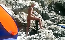 Beach nude blonde creaming her hot body