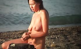 On nudist beach naked girl