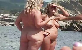 Two blonde moms naked on beach