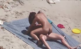 Horny brunette is wild beach sex