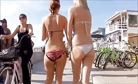 Following two hot babes in bikini